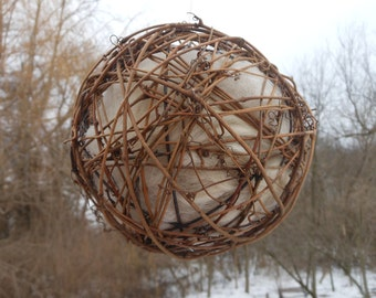 "6"" grape vine ball filled with llama or alpaca fiber for birds to use to make their nests"