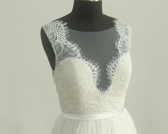 Deep V Neckline A line tulle lace wedding dress with very pale blush lining