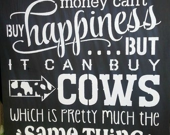 Money can buy cows sign