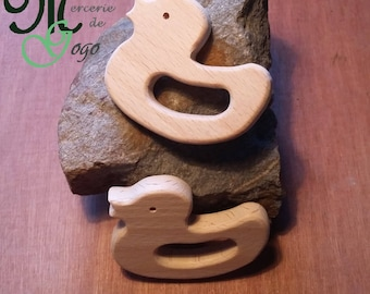Natural wooden teething ring. Duck shape.