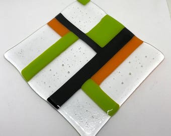 Fused Glass Art Piece made by DENO with green, black, orange, and clear glass