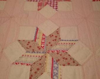 Twinkling LeMoyne Star or Twinkling Diamond Star with pale pink border!