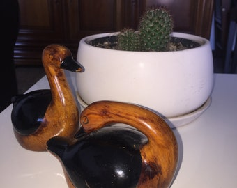 Two hand carved and painted wooden ducks