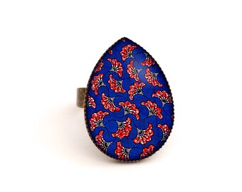 Cabochon ring • African wax pattern • blue red brass drop glass