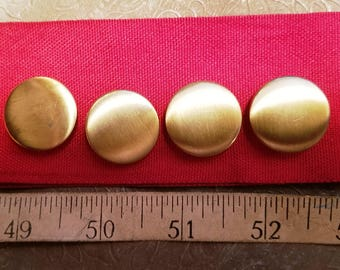 Four golden shanked buttons