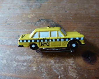 NYC Taxi pin plastic