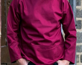Artist's smock in maroon cotton twill, reversible so pockets can be worn either back or front, available in sizes XS to Medium