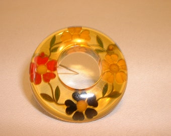 Magnificent Apple Juice Painted and Reverse Carved Wreath Bakelite Pin