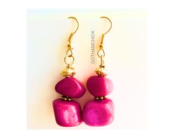 Little Girl in Red Dyed Coral Earrings
