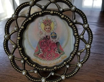 Infant of Prague picture.....circular vintage frame...metal...embedded faux pearls