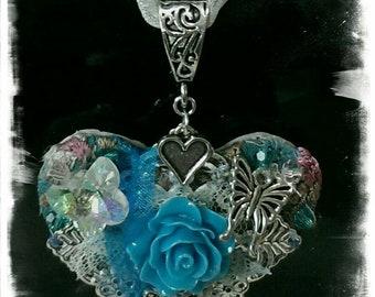 Pretty heart on ribbon pendent.