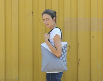 zippered grey geometric canvas tote bag with dots and faux leather handles