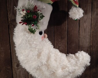 Christmas striped machine quilted hat on a Santa Moon shaped wall hanging or door wreath.  Snowflakes and snowball accent the beard/fabric.