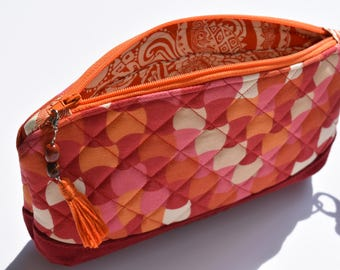 Clematis Wristlet. Quilted Wristlet. Fall Style. Pretty Orange Clutch. Credit Card Slots. Orange Key Fob. Tassel Charm. Red Corduroy.
