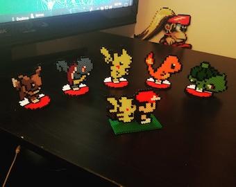 Pokemon 8-bit Sprites on Pokeball Stands