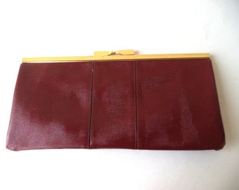 1970s Embossed Leather CLUTCH PURSE. Mod Leather Clutch Purse. Oxblood Clutch Purse. 70s Clutch Purse. Sleek Clutch Purse. Gold Snap Closure