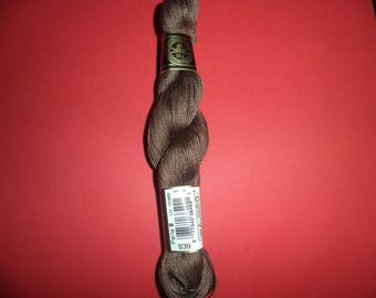 In 25 grams size 8 DMC Perle cotton: ref 839 (Brown)