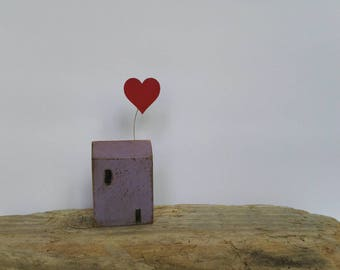 Small wooden house with love heart balloon. Unique wedding, new home, best friend, mother's day gift