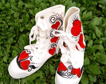 High sneakers with red hearts