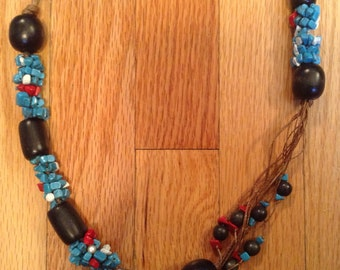 Long necklace with turq. Coral and wooden beads on wax cord