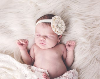 baby baptism pearl rhinestone flower in antique ivory or pure white on soft stretch headband newborn to 6 years