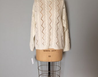 snow white cut out fishnet sweater | braided cable knit fisherman sweater