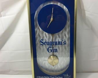 "Vintage Seagram's Gin Pendulum Clock Plastic Frame - 21"" X 11"""