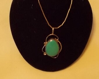Sterling Silver and Turquoise Pendant on a sterling chain. (365)
