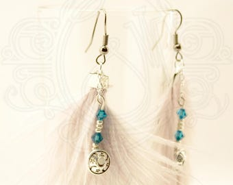 Grey ostrich feather earrings and Pearl.