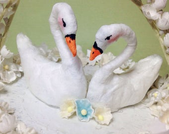 Spun cotton swans and vintage lily of the valley wedding cake topper