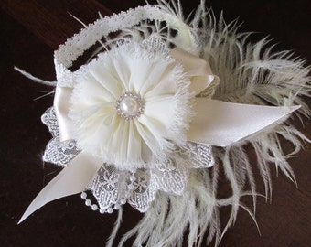 Beautiful off white headband with a silk flower flower with bling center, ostrich feather, on lace and satin ribbon