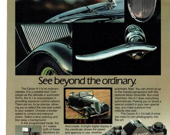 1983 Advertisement Canon A-1 Camera 35mm Film Lincoln Greyhound Hood Ornament Photography Collector Classic Car Wall Art Studio Decor
