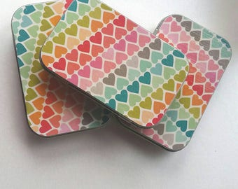 Large tin . . .rainbow hearts.