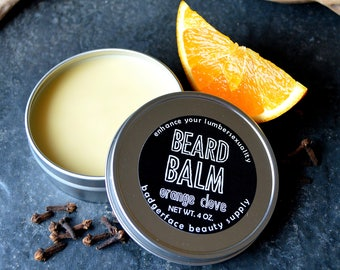 Beard Butter. Beard Balm. Orange Clove. 4 oz / 113 g. Beard Conditioner. Beard Balm All Natural. Beeswax. Cocoa Butter. Shea Butter.