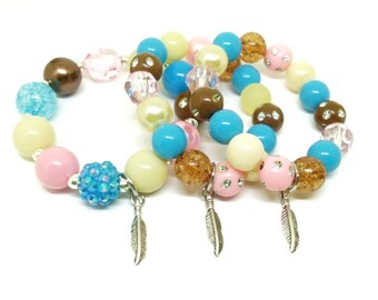Pocahontas themed bracelets party favors in organza bags with special birthday girl bracelet!