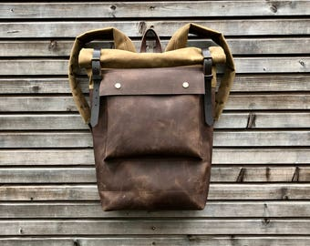 Leather backpack with waxed canvas  roll to close top and leather front pocket