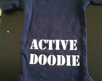 Active doodie onsie. Front of onsie has small military branch of choice and baby name