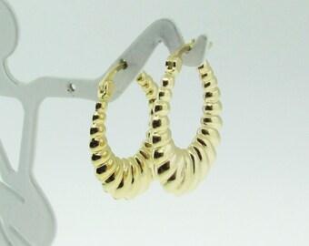14 K gold hoop earrings.
