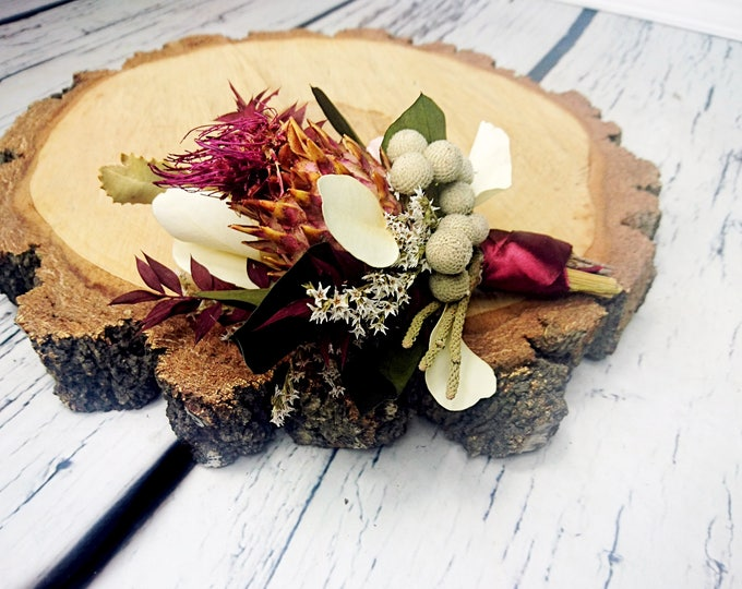 Tropical flowers boutonniere in shades of wine, pink, cream and green. Perfect for boho wedding