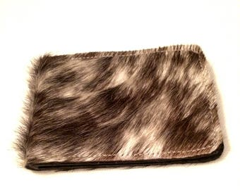 Black and white fluffy genuine leather cardholder. Protecting inlayer