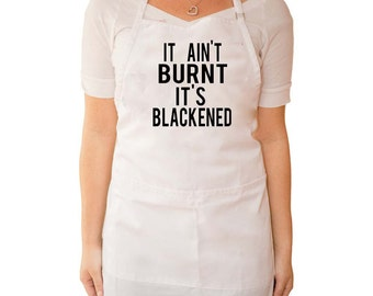 """Apron, Cooking Saying """"It Ain't Burnt it's Blackened"""""""