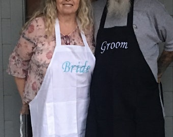 A set of aprons for the bride and groom