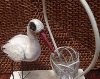 Antique spun cotton stork and flower basket