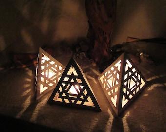 Tetrahedron ceramic candle holder / shadow lamp with symmetric merkaba patterns