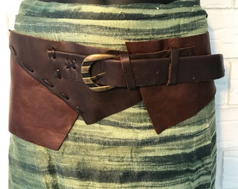 Two tone brown textured soft leather belt with bronze buckle and structured raw edge.