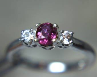RUBY- Genuine Red with Magenta flashes .925 Sterling Ring 0.58 carats with White Sapphire accents!