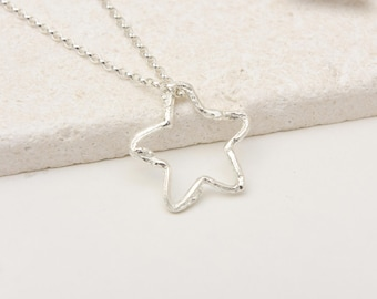 A sterling silver twig star necklace