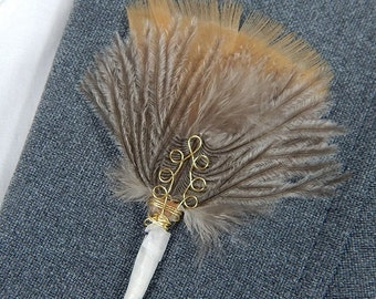 Bronze ostrich feather boutonniere accented with gold circle ornament for wedding or prom