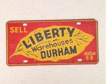 Vintage advertising sign, advertising tin, Liberty Warehouses Durham, North Carolina, car license plate tag, 1940s tobacciana collectible