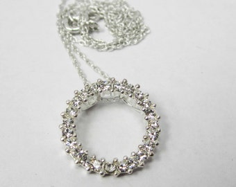 ONE STERLING silver circle pendant with crystals